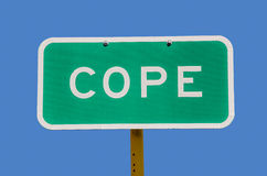 Cope Sign. Sign for the town of Cope, Colorado.  Use it for anything that applies to the words cope, coping, cope with, deal with, get by, face, handle, etc Stock Photo