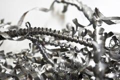 Copeaux en acier en spirale tordus par plan rapproché. Industrie de perçage Photos libres de droits