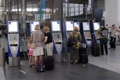 Copenahgen airport. KASTRUP/COPENAHGEN/ DANMARK /DENMARK.  Passenger checking at self check SAS machines at Copenhagen International Airport(Lufthavn)  on 2 Stock Photography