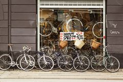 Copenhagen bicycle shop. Copenhagen, Denmark, 5 September 2017: Typical window case of a local bicycle shop having price discounts in Copenhagen Royalty Free Stock Image