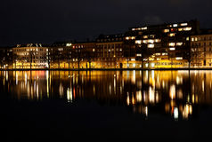 Copenhagen buildings reflected in water. At night Royalty Free Stock Images