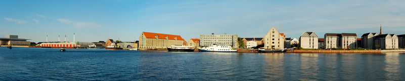 Copenhagen canal panorama. One of the most popular canal in Copenhagen with Opera House, historical buildings, The Church of Our Saviour, specific chimneys and Royalty Free Stock Photography