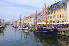 Copenhagen, Denmark. Nyhavn street in Copenhagen, Denmark.  One of many tourist hotspots and boasts the longest bar in Europe