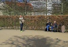 Men are playing petanque outdoor in public park, Copenhagen Stock Photo