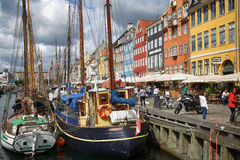 COPENHAGEN, DENMARK - AUGUST 14, 2016: Boats in the docks Nyhavn Stock Images