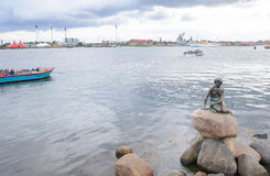 Copenhagen, Denmark - August 25, 2014-The Little Mermaid bronze statue monument by Edvard Eriksen.This displayed on a rock by t. He waterside at the Langelinie stock images