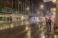 COPENHAGEN, DENMARK - AUGUST 28, 2016: Night rainy view of Vesterbrogade street in Copenhagen, Denmar royalty free stock images