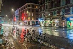 COPENHAGEN, DENMARK - AUGUST 28, 2016: Night rainy view of Vesterbrogade street in Copenhagen, Denmar royalty free stock photos