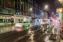 COPENHAGEN, DENMARK - AUGUST 28, 2016: Night rainy view of Vesterbrogade street in Copenhagen, Denmar stock photos