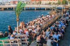 COPENHAGEN, DENMARK - AUGUST 26, 2016: People sit at a beer garden at the sea coast in Copenhagen, Denma stock photography