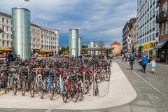 COPENHAGEN, DENMARK - AUGUST 28, 2016: Rows of bicycles at Norreport in Copenhage royalty free stock image