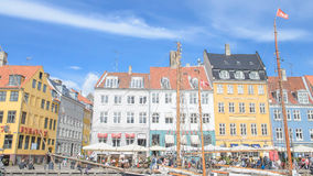 Copenhagen, Denmark - August 25, 2014 - Scenic summer view of Nyhavn pier canel with color buildings, ships, yachts, boats,unident Stock Photo