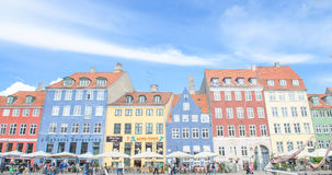 Copenhagen, Denmark - August 25, 2014 - Scenic summer view of Nyhavn pier canel with color buildings, ships, yachts, boats,unident Royalty Free Stock Photo