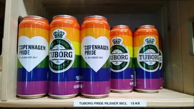 Special bright rainbow pack cans beer Tuborg on store shelves Carlsberg brewery royalty free stock image