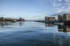 Copenhagen, Denmark - blue skies and seas. This image shows a canal in Copenhagen, Denmark. It was taken on a sunny day in November 2017. Beautiful blue skies Royalty Free Stock Photos