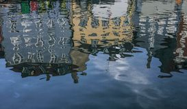 Copenhagen, Denmark - colorful buildings - reflection in the water. This image shows a canal in Copenhagen, Denmark. It was taken on a sunny day in November Stock Photos