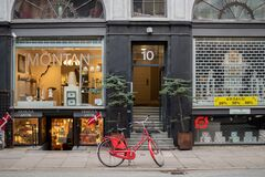 Free COPENHAGEN, DENMARK – Designer Storefronts On One Of The Streets Stock Image - 182139171