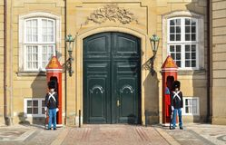 COPENHAGEN, DENMARK - FEBRUARY 27 : Royal guards at Amalienborg Slot in Copenhagen - Denmark. This palace is the home of the stock photography