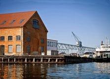 Copenhagen, Denmark: harbor installations, docks and a ship moored Royalty Free Stock Images