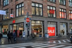 H&M 50% sale in reatil store in Copenhagen Denmark. Copenhagen/Denmark. 14.January 2019._ 50% off sale at Swedis retail store H&M hennes & Maurit o stroeget in royalty free stock image