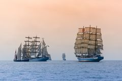 Sailing ships of various types compete in regatta royalty free stock images
