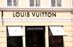 Louis Vuitton Logo sign panel on shop. Louis Vuitton is a famous high end fashion house manufacturer and luxury retail company fro royalty free stock image