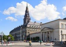 Copenhagen. DENMARK - JUNE 30: People biking near by Christiansborg Palace on June 30, 2014 in Stock Photos