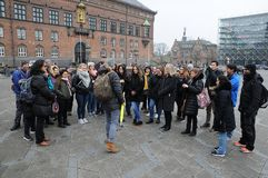 FREE TOUR GETHERING WITH TOURISTS. Copenhagen /Denmark / 2...March.2018_ . Holiday makers waiting with other for Free Tour pay donations only royalty free stock photos