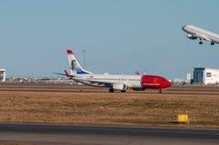 Norwegian Boeing 737-800 airplane in Copenhagen airport. Copenhagen Denmark - March 18. 2018: Norwegian Boeing 737-800 airplane in Copenhagen airport Royalty Free Stock Image