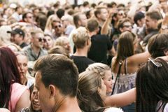 Crowd of young people drinking dancing and enjoying themselves at music venue - black and white image Stock Image