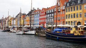 COPENHAGEN, DENMARK - MAY 31, 2017: Nyhavn a 17th century harbour in Copenhagen with typical colorful houses and water canals Stock Image