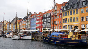 COPENHAGEN, DENMARK - MAY 31, 2017: Nyhavn a 17th century harbour in Copenhagen with typical colorful houses and water canals Stock Photos