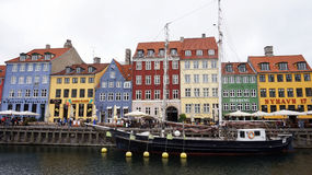 COPENHAGEN, DENMARK - MAY 31, 2017: Nyhavn a 17th century harbour in Copenhagen with typical colorful houses and water canals Stock Photography