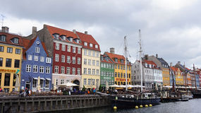 COPENHAGEN, DENMARK - MAY 31, 2017: people in open cafes of the famous Nyhavn promenade. Nyhavn a 17th century harbour Stock Images