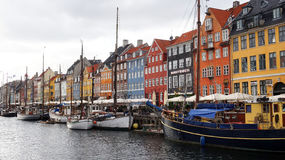 COPENHAGEN, DENMARK - MAY 31, 2017: people in open cafes of the famous Nyhavn promenade. Nyhavn a 17th century harbour Royalty Free Stock Image