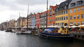 COPENHAGEN, DENMARK - MAY 31, 2017: people in open cafes of the famous Nyhavn promenade. Nyhavn a 17th century harbour Stock Photography