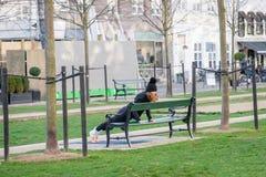 Copenhagen, Denmark. November 27, 2018. Girl doing exercise strap on the street. Challenge concept. Copenhagen, Denmark. November 27, 2018. Girl doing exercise stock photos