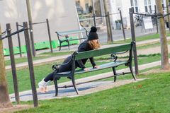 Copenhagen, Denmark. November 27, 2018. Young woman doing exercise strap on the street. Copenhagen, Denmark. November 27 2018. Young woman doing exercise strap royalty free stock images