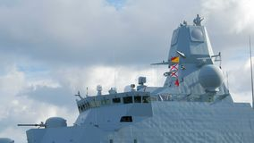 Copenhagen, Denmark - OCT, 2016: close-up shot of coast guard ship, deckhouse, gun, flags, near shore of Copenhagen. 4K stock video footage