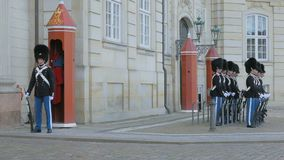 Copenhagen, Denmark - OCT, 2017: soldiers of Royal Life Guards are standing at place in front of Amalienborg Palace. 4K stock video