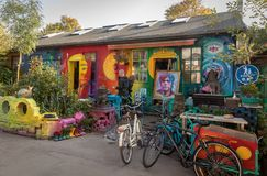 COPENHAGEN, DENMARK - October 2018: Small, colorful art shop in Freetown Christiania, a self-proclaimed autonomous. Small art shop with bicycles outside stock image