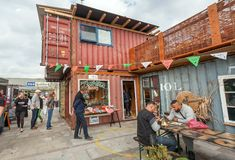 People eating fast food at popular market Reffen, street food and urban area for start-ups. COPENHAGEN, DENMARK - SEPT 7: People eating fast food at popular royalty free stock photos