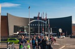 People walking on the sidewalk in front of Fisketorvet shopping mall. Copenhagen Denmark - September 26. 2011: People walking on the sidewalk in front of Stock Photo
