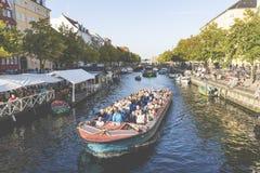 COPENHAGEN, DENMARK - SEPTEMBER 8: Unknown tourists touring the Old Canal in Copenhagen Stock Photo