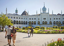 Copenhagen, Denmark: Tourists and Moorish Palace at Tivoli Gardens. Copenhagen, tourists in front of the Moorish Palace at Tivoli Gardens with beautiful fountain stock photo