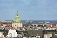 Copenhagen Frederik`s Church View, Denmark. View over central Copenhagen, Denmark with the dome of Frederik`s Church in the center and the Swedish coastline in Royalty Free Stock Image