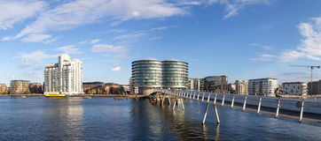 Copenhagen harbor with modern cyclist bridge. Copenhagen, Denmark - September 23, 2016: Modern cyclist bridge Bryggybroen and modern residential buildings Stock Photos