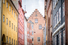 Copenhagen Historical City Centre. Copenhagen, Denmark - July 30, 2017: Colorful houses in Magstraede, one of the oldest roads in the historic city center royalty free stock image
