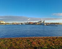 Copenhagen Industrial area district along sea with clear blue sky during sunset time stock photo