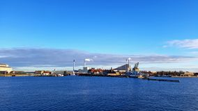 Copenhagen Industrial area district along sea with clear blue sky during sunset time stock image